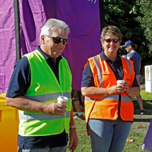 Craig and Carolyn Hedley at their first Buddy Walk - seen here enjoying the sun and a coffee while waiting for things to get underway.