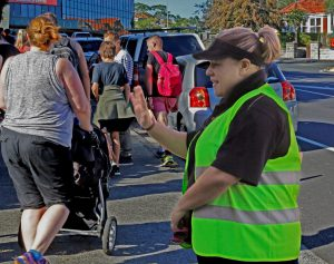 Club Secretary Wendy Coyle stopping traffic